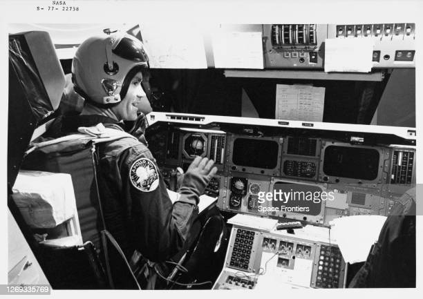 American NASA astronaut Fred Haise wearing a jumpsuit with the mission insignia of Apollo 13 in the cockpit of the Orbiter Aeroflight Simulator ahead...