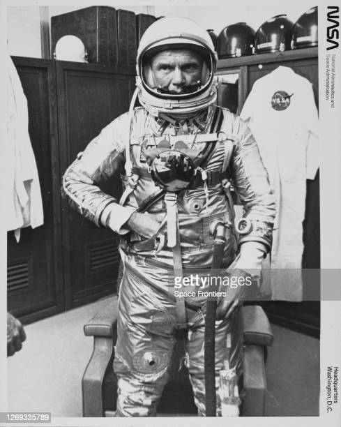 American NASA astronaut John Glenn adjusts his space suit as he prepares to leave for the launch of the Friendship 7 mission from Cape Canaveral Air...