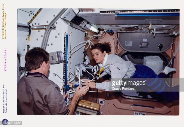 American NASA astronaut Kent Rominger and Canadian CSA astronaut Julie Payette in the US-built Unity node during outfitting of the International...
