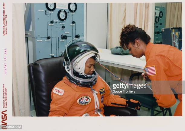 American NASA astronaut Mae Jemison having her suit inspected by technician Sharon McDougle at the Operations and Checkout Building ahead of the...