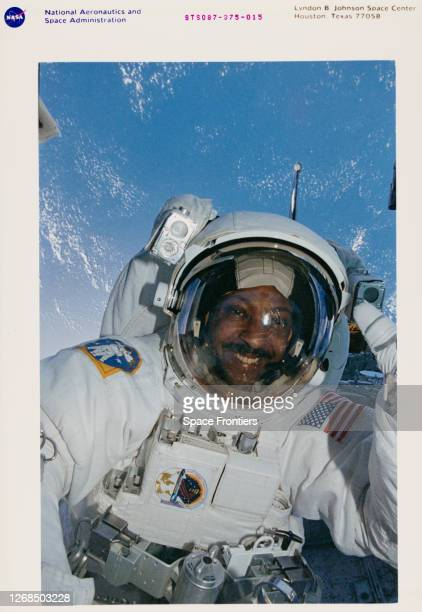 American NASA astronaut Winston E Scott mission specialist during one of two extravehicular activities in the cargo bay of the Earthorbiting Space...