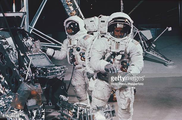 American NASA astronauts Alan Bean and Pete Conrad rehearse and practice duties and experiments with equipment in front of a simulated lunar module...