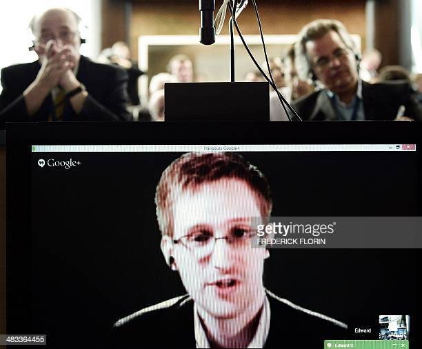 American National Security Agency whistleblower Edward Snowden speaks to European officials via videoconference during a parliamentary hearing on...