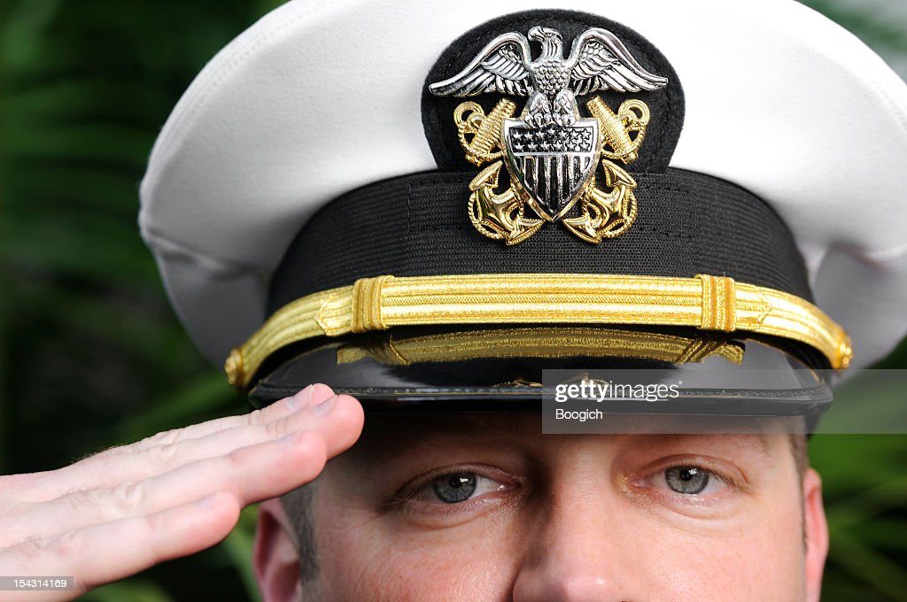 American Navy Officer Salutes with Pride & Strength : Stock Photo