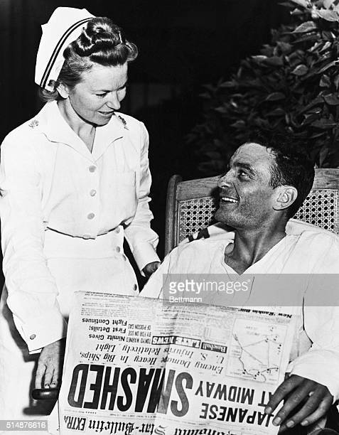 American Navy pilot ensign George H Gay chats with nurse Ann Davidson at a Honolulu Naval Hospital while recovering from wounds suffered during the...
