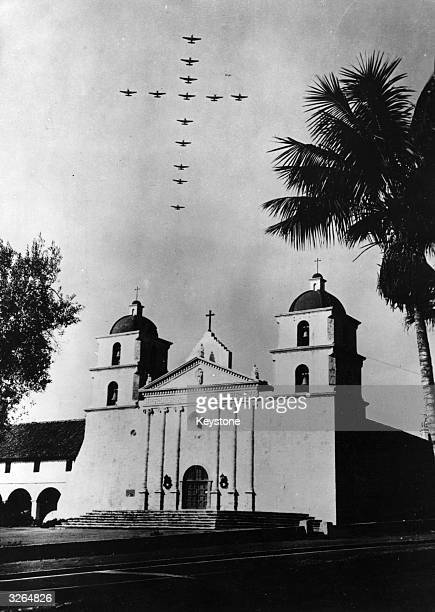 American Navy planes flying in formation in the shape of a cross high above the Santa Barbara Mission in Santa Barbara California