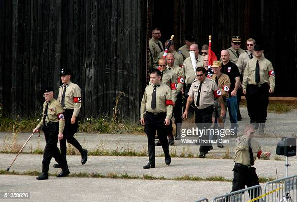 American Nazi party members enter the amphitheater during American Nazi Party rally at Valley Forge National Park September 25 2004 in Valley Forge...