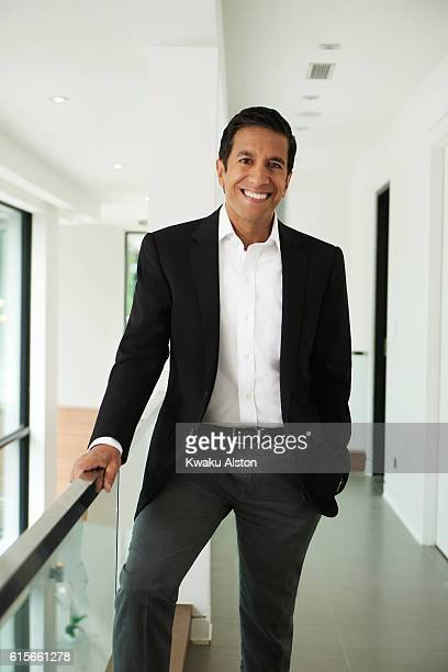 American neurosurgeon and media reporter Sanjay Gupta is photographed for Experience Life on May 16 2016 in Atlanta Georgia