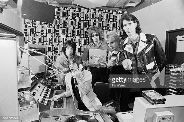 American New Wave band The Cars Drummer David Robinson keyboardist Greg Hawkes guitarist Elliot Easton singer and bass guitarist Ben Orr and...