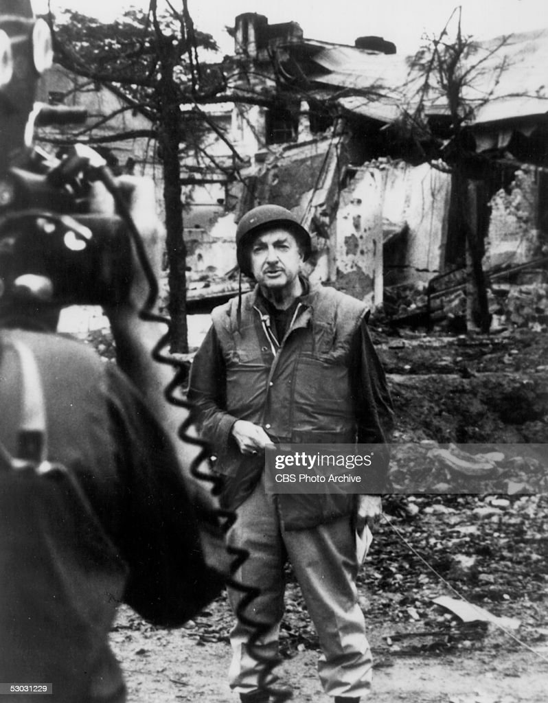 American news broadcaster and CBS anchor Walter Cronkite reports from the site of extensive bombing as he covers the aftermath of the Tet offensive for the TV special 'Report from Vietnam by Walter Cronkite' during the Vietnam War, Vietnam, 1968. Cronkite broke from the standard of objective journalism when he concluded the broadcast with his observation that the war would end in a stalemate. One month later US president Lyndon B. Johnson announced he would not seek reelection.