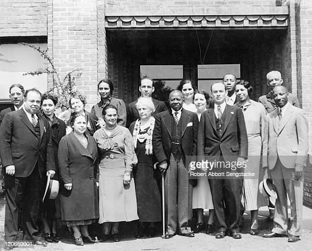 American newspaper publisher Robert Sengstacke Abbott as he poses with unidentified others at Hampton University, Hampton, Virginia, 1937.