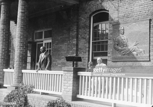 American newspaper publisher Robert Sengstacke Abbott delivers a speech from the porch of an unspecified building on the campus of the Hampton...