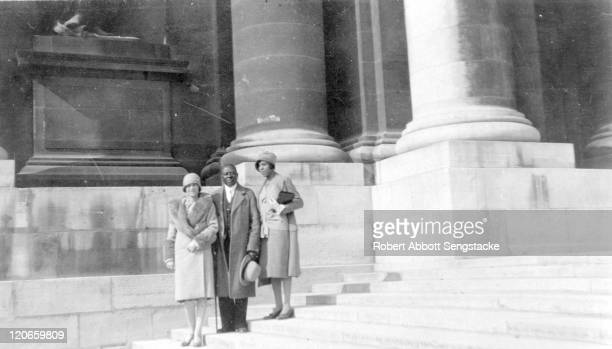 American newspaper publisher Robert Sengstacke Abbott poses with his wife Helen Thornton Morrison , and opera singer Roberta Dodd Crawford , Paris,...
