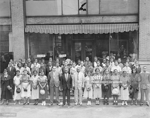 American newspaper publisher Robert Sengstacke Abbott poses with honor students and faculty from Atlanta's Booker T Washington High School 1936