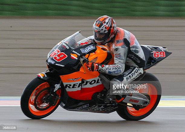 American Nicky Hayden powers his Honda GP during a free practice of the Valencia Grand Prix at the Cheste race track near Valencia 31 October 2003...