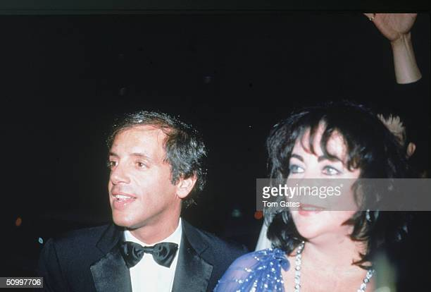 American night club owner Steve Rubell and Britishborn American actress Elizabeth Taylor at a benefit for Martha Graham Dance Company at Rubell's...