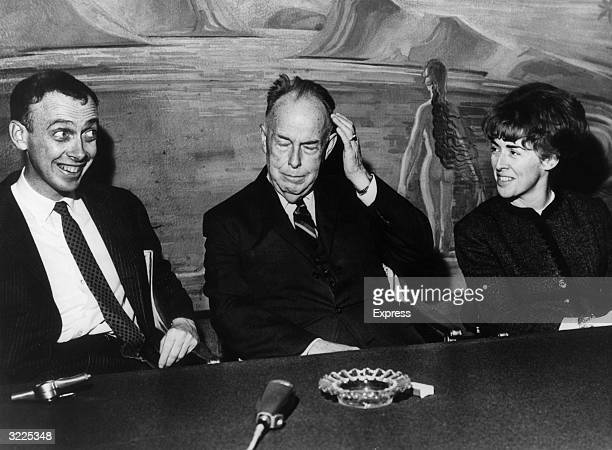 American Nobel Prizewinning biochemist James Dewey Watson with his father James D Watson and sister Mrs Elizabeth Meyers sitting at a table in the...