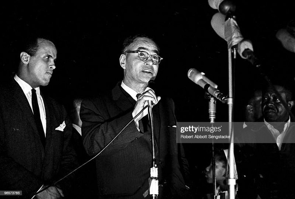 American Pulitzer-Prize winning political scientist and diplomat Ralph Bunche (1904 - 1971) speaks at the 'Stars for Freedom' rally, Montgomery, Alabama, March 24, 1965. The rally occured on the last night of the historic Selma to Montogmery march in support of voter rights; the following day, 25,000 marchers, led by American Civil Rights leader Dr. Martin Luther King Jr., arrived at the State Capitol Building and listened to King deliver his 'How Long, Not Long' speech. Singer and activist Harry Belafonte (left) and Reverend Ralph Abernathy (1926 - 1990) (right) stand behind him.