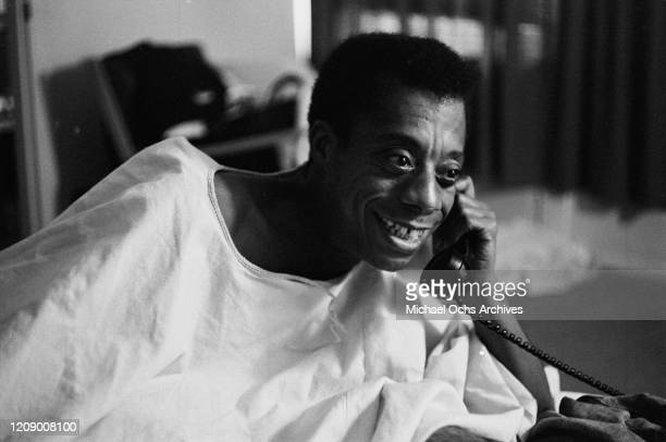 American novelist and activist James Baldwin on the telephone USA October 1963