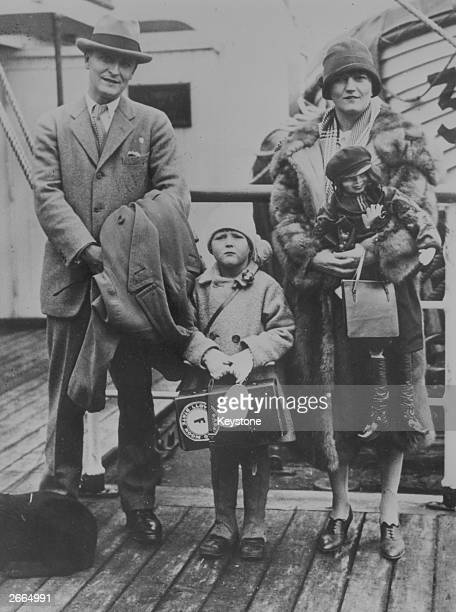 American novelist F Scott Fitzgerald with his wife, Zelda, and daughter on a liner's deck.