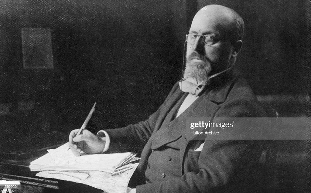 American novelist Henry James (1843 - 1916) in his study.