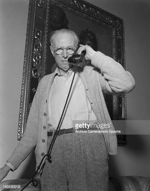 American novelist Lewis Sinclair portrayed while answering the telephone Venice 1949