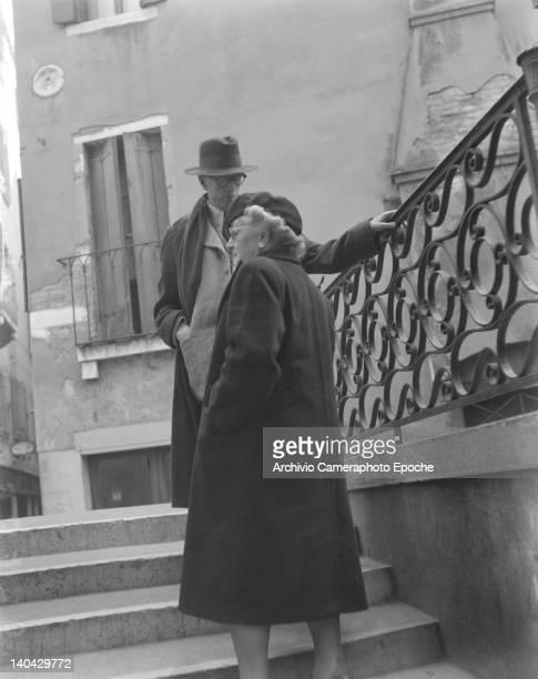 American novelist Lewis Sinclair standing with Mrs Katherine Powers on a bridge Venice 1949