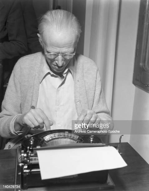 American novelist Lewis Sinclair typing on his typewriter Venice 1949