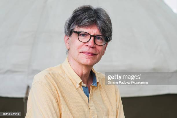 American novelist Richard Powers attends a photocall during the annual Edinburgh International Book Festival at Charlotte Square Gardens on August 21...