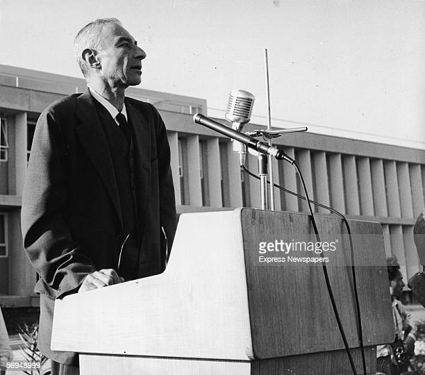 American nuclear physicist and father of the atom bomb Robert Oppenheimer stands at a podium and addresses an audience at the inauguration of the the...
