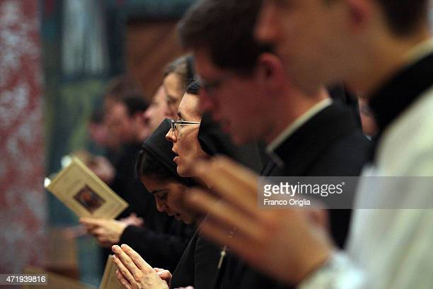American nuns and priests attend a mass held by Pope Francis at the Pontifical North American College at the end of a conference on the canonization...
