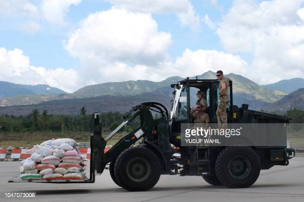 American officers transport supplies for quaketsunami affected people in Palu Indonesia's Central Sulawesi on October 7 following the September 28...