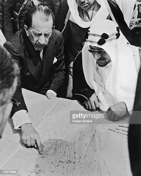 American oil magnate J Paul Getty points out the town of Al Wafrah on a map of southern Kuwait to King Saud bin Abdul Aziz of Saudi Arabia 1954