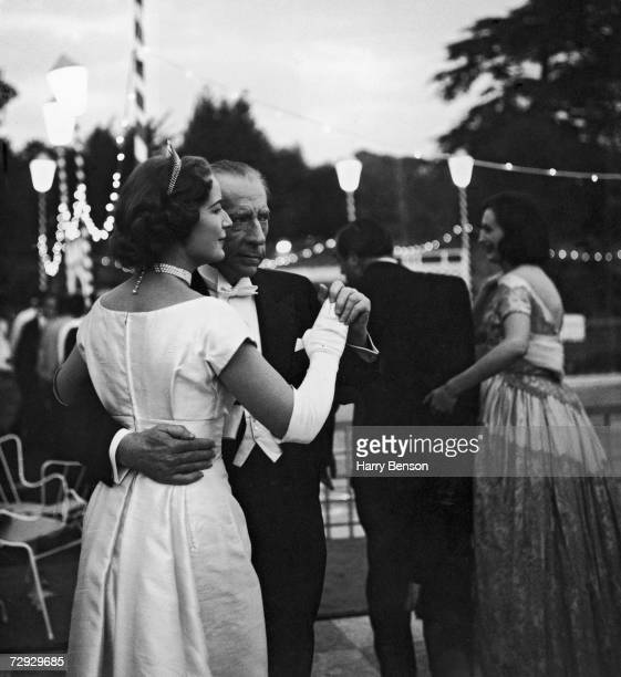 American oil magnate millionaire and art collector J Paul Getty dances with his English solicitor Robina Lund at a ball held at his home at Sutton...