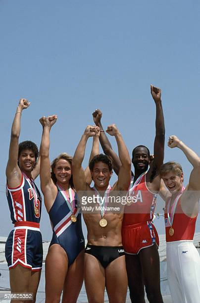 American Olympic athletes pose together wearing the medals they won in the 1984 Summer Games From left to right Cheryl Miller basketball Nancy...