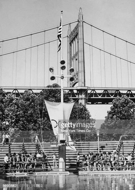 American Olympic gold medalists Gertrude Ederle and Sammy Lee raise the Olympic banner at the US Olympic 3m springboard diving trials at the Astoria...