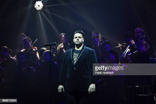 American operatic and classical crossover tenor Fernando Varela performs live on stage during the Royal Christmas Gala at the Tempodrom on December 5...