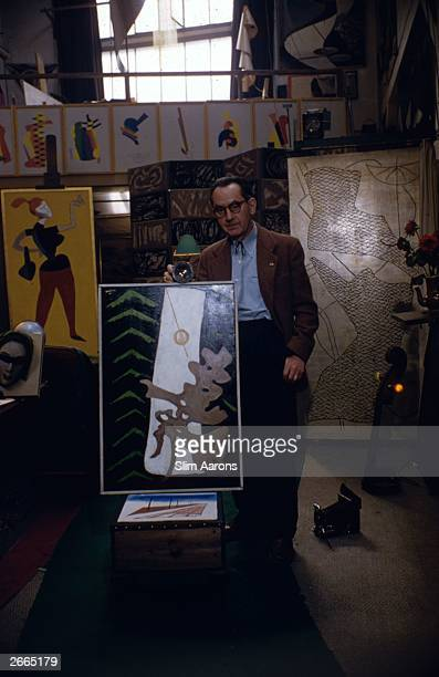 American painter and photographer Man Ray at his Left Bank studio in Paris.