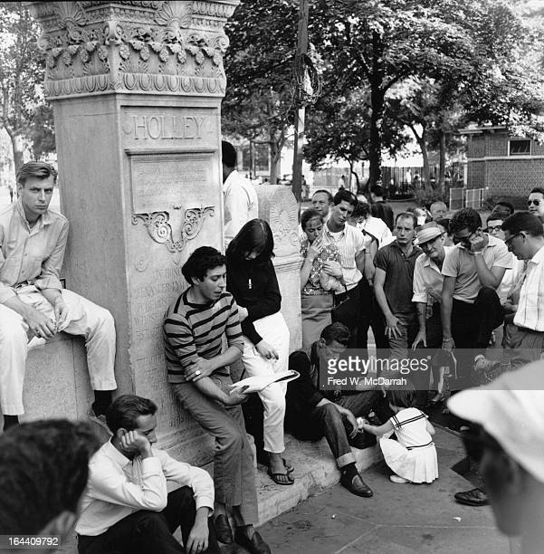 American painter and poet William Morris reads poetry to an audience in Washington Square Park New York New York July 26 1959 Morris had been...
