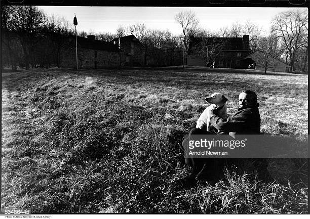 American painter Andrew Wyeth poses for portrait with his dog December 2 1976 in Chadds Ford Pennsylvania