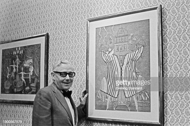 American painter Perkins Harnly , UK, 3rd May 1973. The painting on the right is his 1973 work 'Lightning Strikes'.