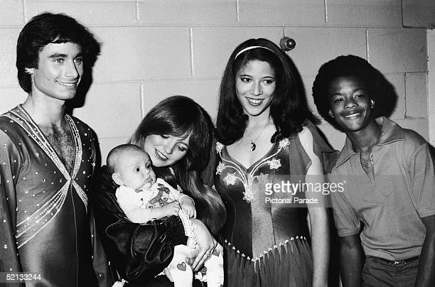 American pairs figure skaters Randy Gardner and Tai Babilonia pose with Susan Richardson of 'Eight is Enough' fame her daughter Sara and Todd Bridges...