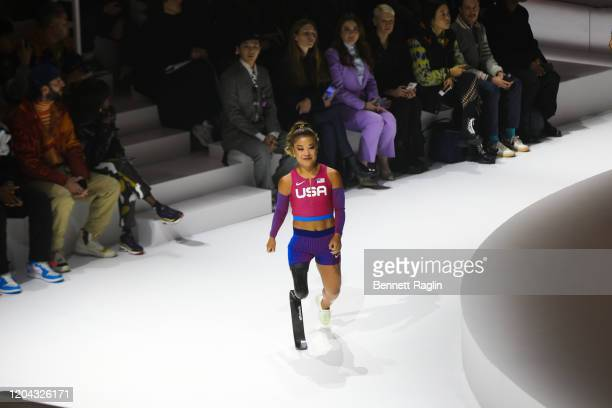 American Paralympic Track Field athlete Scout Basset walks the runway during the 2020 Tokyo Olympic collection fashion show at The Shed on February...