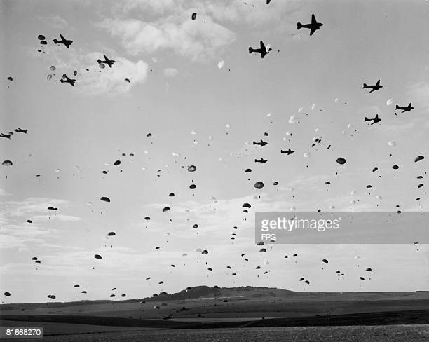 American paratroops make a mass jump during training in England, circa 1944.