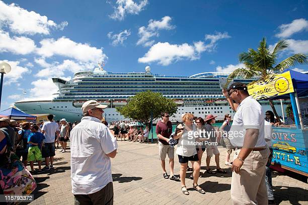 American passengers from a cruise ship are welcomed in the harbour of Kralendijk on February 3, 2011 on the island of Bonaire. Bonaire has earned a...