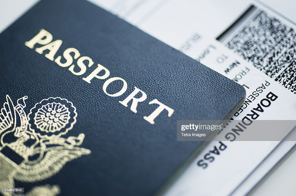 American passport with boarding pass inside : Stock Photo