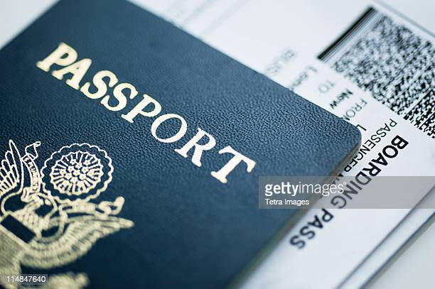american passport with boarding pass inside - passeport photos et images de collection