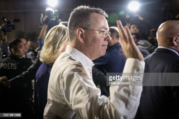 American pastor Andrew Brunson waves to the media as he arrives at the Izmir International Airport CIP terminal to depart Turkey on October 12 2018...