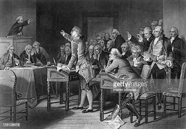 American patriot Patrick Henry center with right arm raised gives his famous 'Give me liberty or give me death' speech in front of the Virginia...