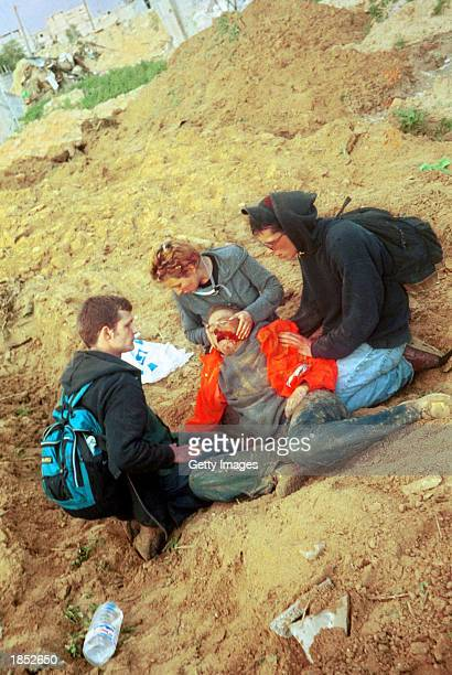 American peace activist Rachel Corrie lies bleeding while being helped by colleagues after she was killed by an Israeli bulldozer March 16 2003 in...